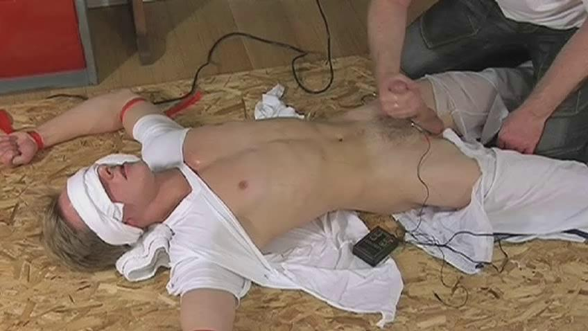Blindfolded and tied guy gets his cock stroked