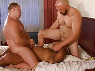 Three chubby gay hunks having a hot gang bang