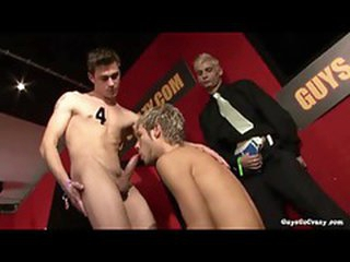 Guys sucking cock in a group sex scene