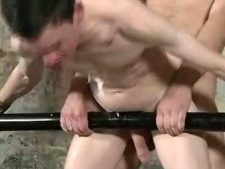 Restrained hunk gets some hot wax added to anal sex