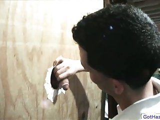 Dude jerking & sucking cock from glory hole